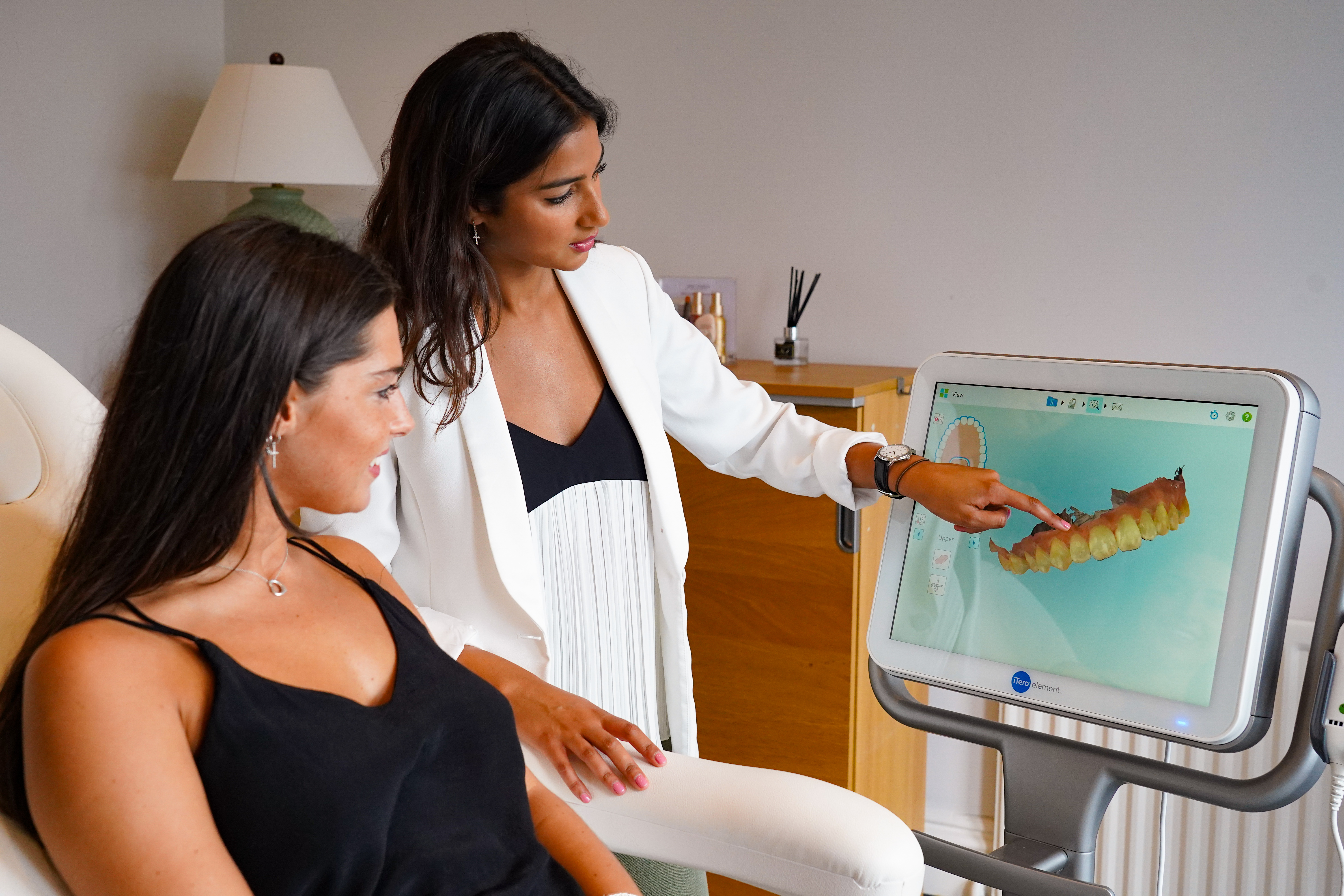 Honour Health dentist in Newcastle showing Invisalign simulation to patient.